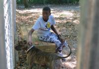 Kevon works with dog at Humane Society