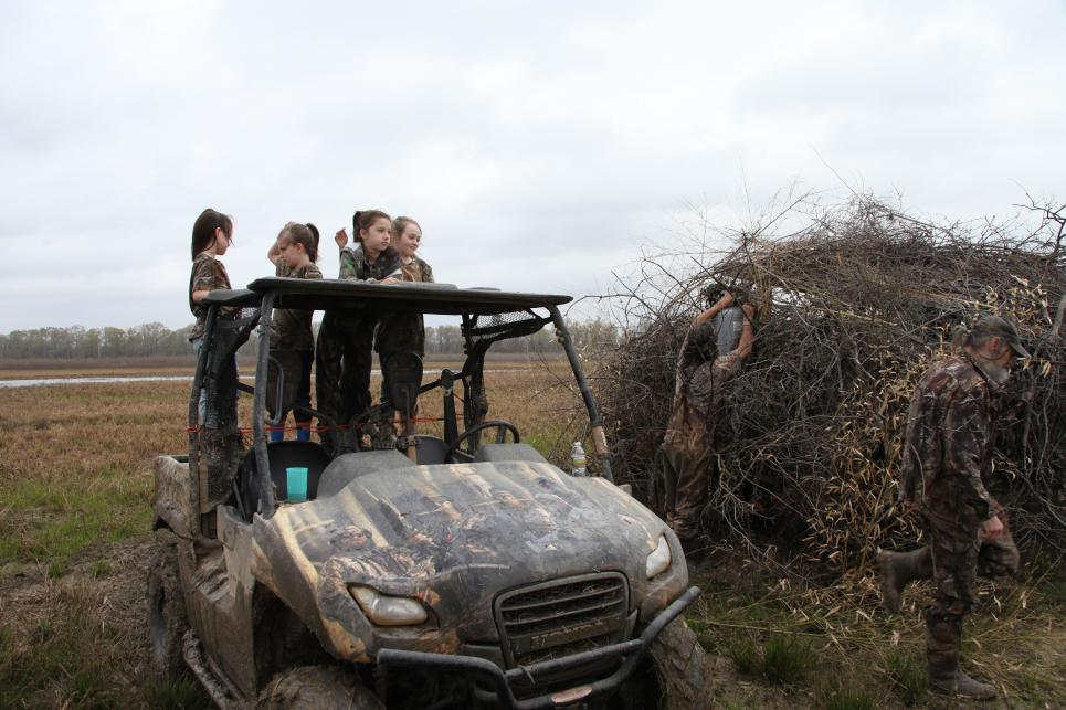Phil's granddaughters have tea party in jeep