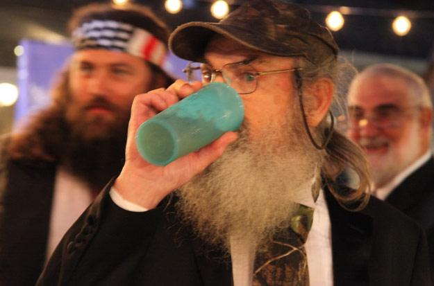 Si drinks  from blue cup