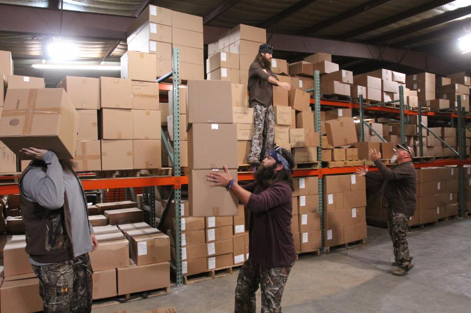 Duck Commander carries boxes