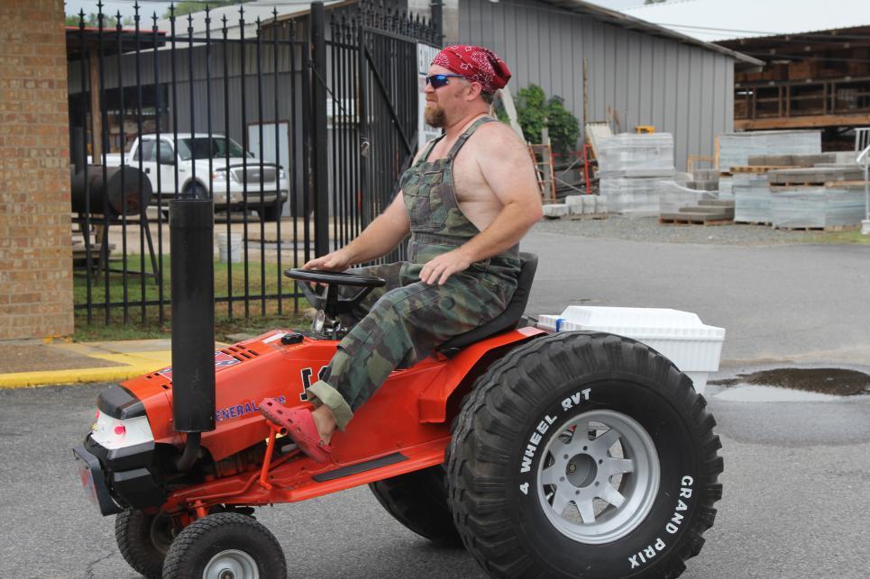 Phillip McMillan rides lawn mower