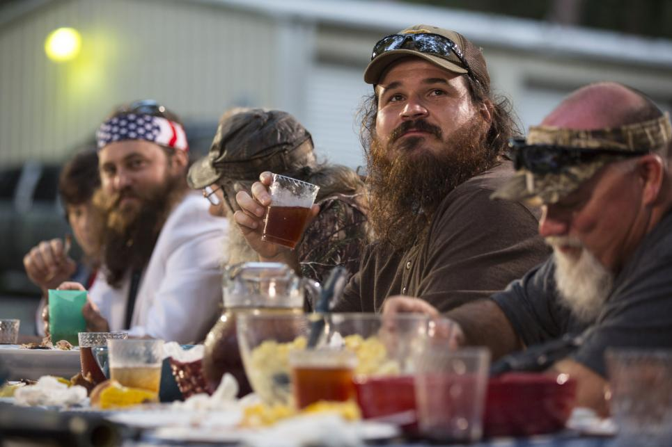 Justin eats  dinner with Robertson family