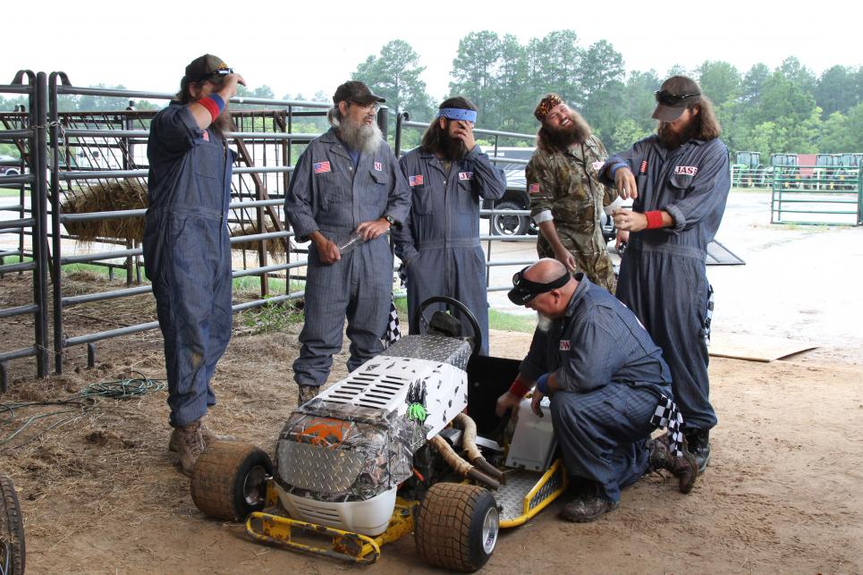 Pit crew inspects Willie's lawn mower
