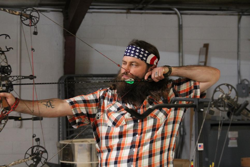 Willie Robertson aims at a target