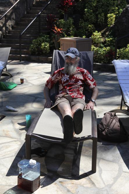 Si in red shirt at pool in Hawaii