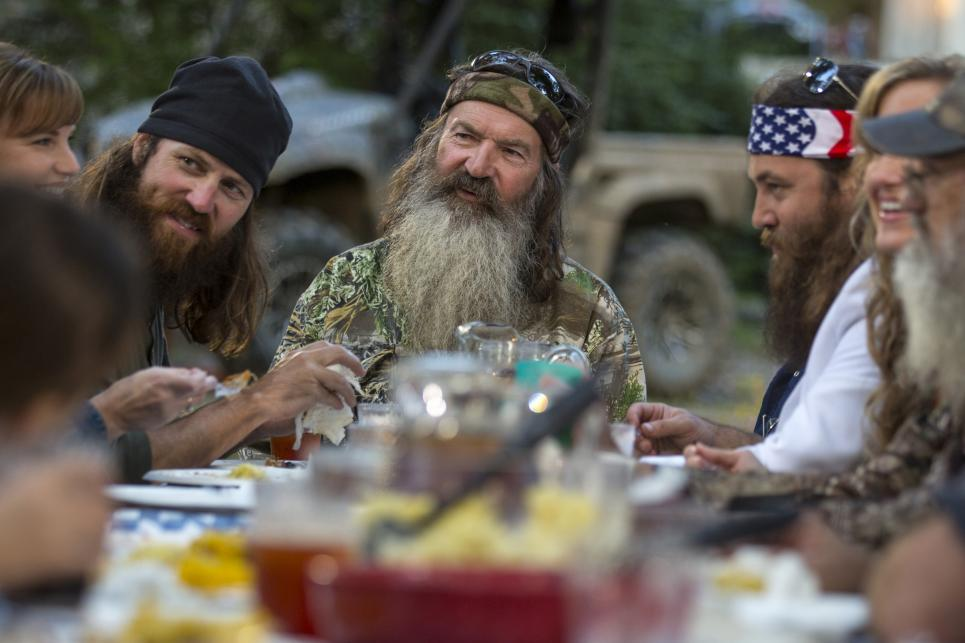Phil Robertson sits with family at picnic table