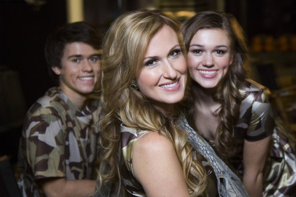 Korie poses with her kids during camo shoot