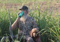 Si and his new poodle hunting dog