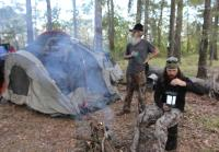 Si and Jase hang out at campsite