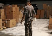 Jase sprinkles flour on warehouse floor