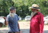 Si and Squirrel negotiate price of  truck
