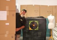 Godwin hides behind boxes