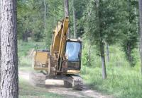 Phil rides his backhoe