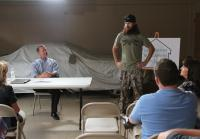 Jase gives speech at Homeowners Association meeting