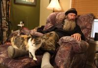 Phil Robertson sits with cat