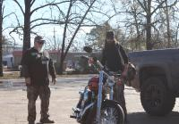 Jase and Godwin notice motorcycle at Duck Commander