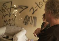 Scott  Amie find graffiti in condo