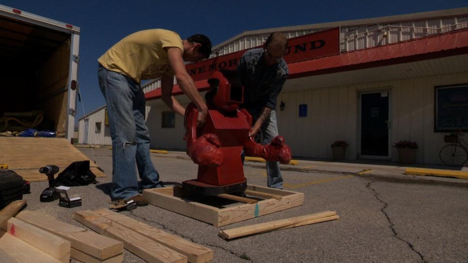 Jarrett Joyce loads robot into crate