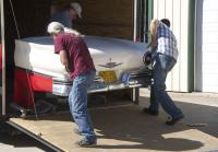 Roy finishes loading Ford Fairlane
