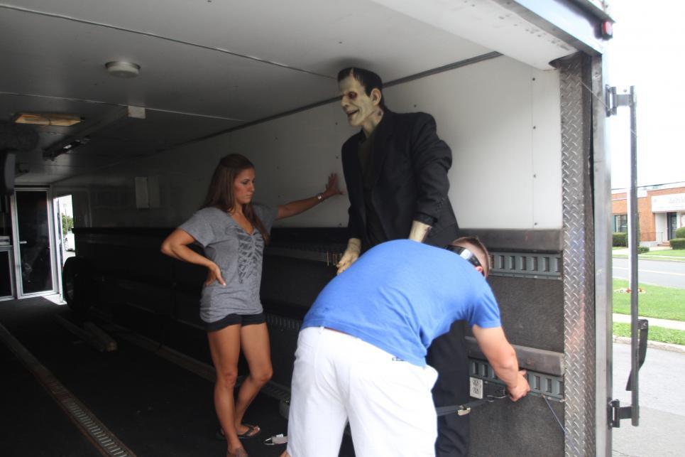 Chris and Robbie load Frankenstein statue