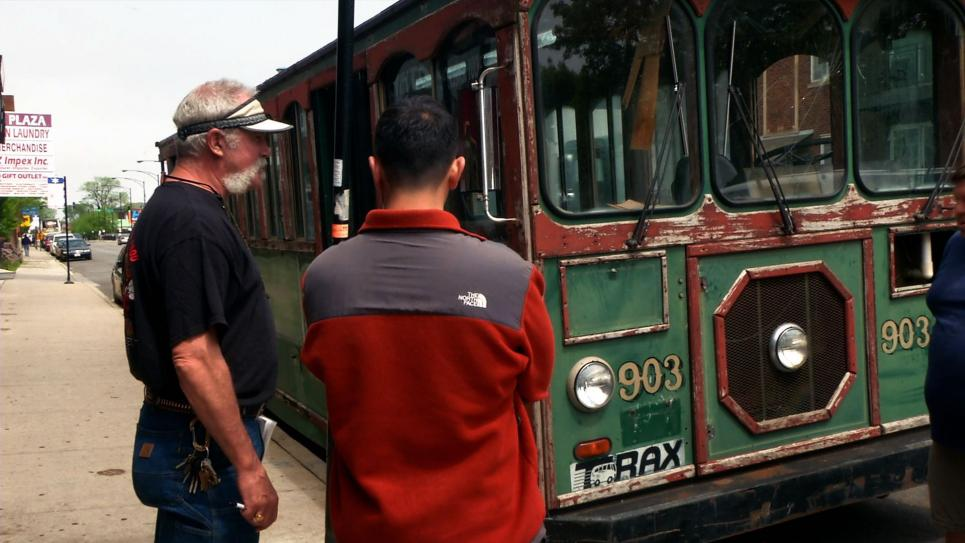 Marc and buyer assess damage to trolley