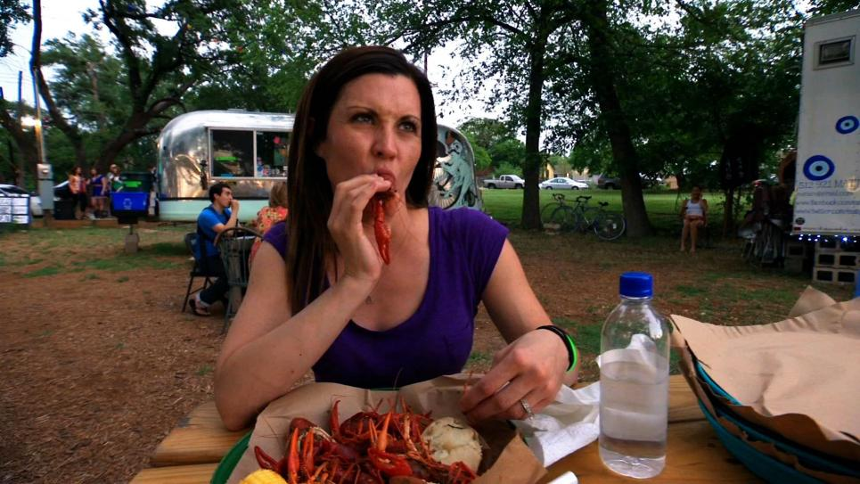 Jennifer eats crawfish