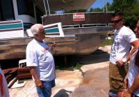 Chris and Robbie must load houseboat without crane