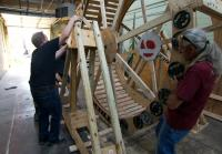 Roy loads human-sized hamster wheel