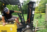 Chris tries forklift to lift shed