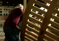 Roy helps unload hamster wheel