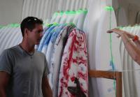 Jarrett prepares to ship surfboards
