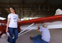Jennifer waits for seller to detach wings of plane