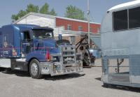 Marc Springer helps unload Greyhound Cruiser
