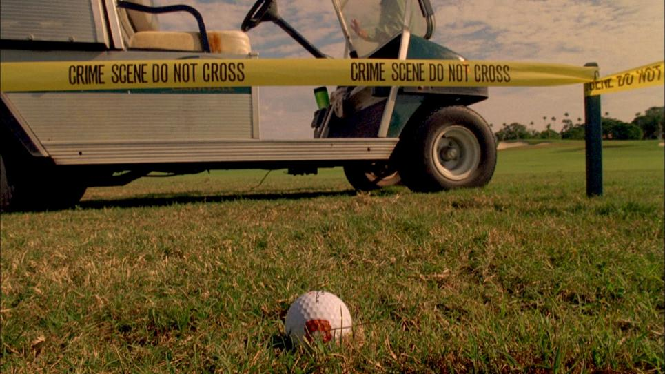 Jim block off golf ball with crime scene tape