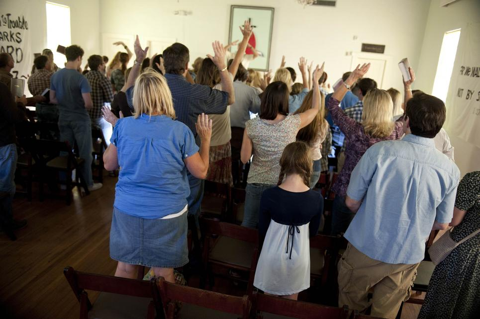 Worshippers pray at murder scene church