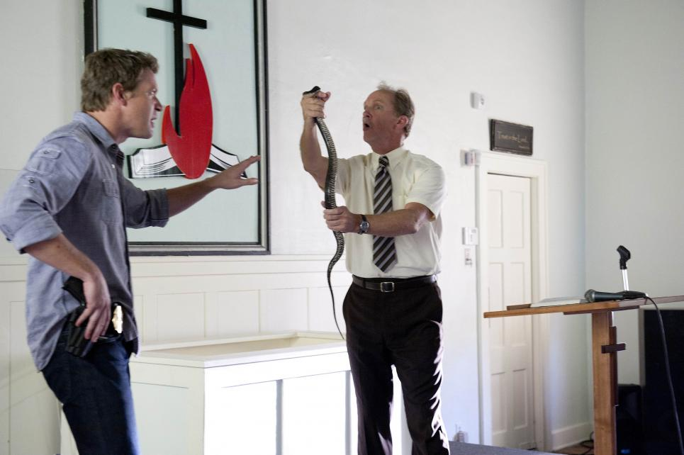 Reverend tries to get Jim to hold snake