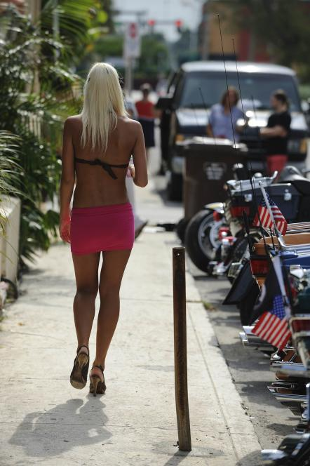 Scantily clad clientele at Cheaters bar