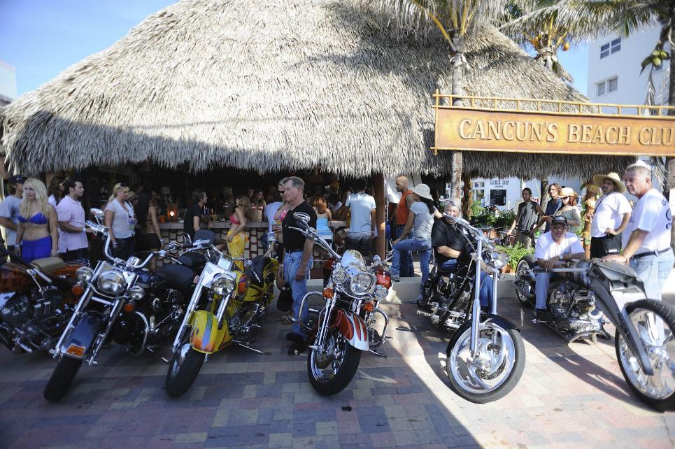 Motorcycles parked at Cheaters bar