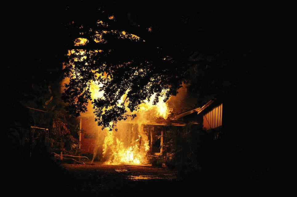 Zelman's house is found burning