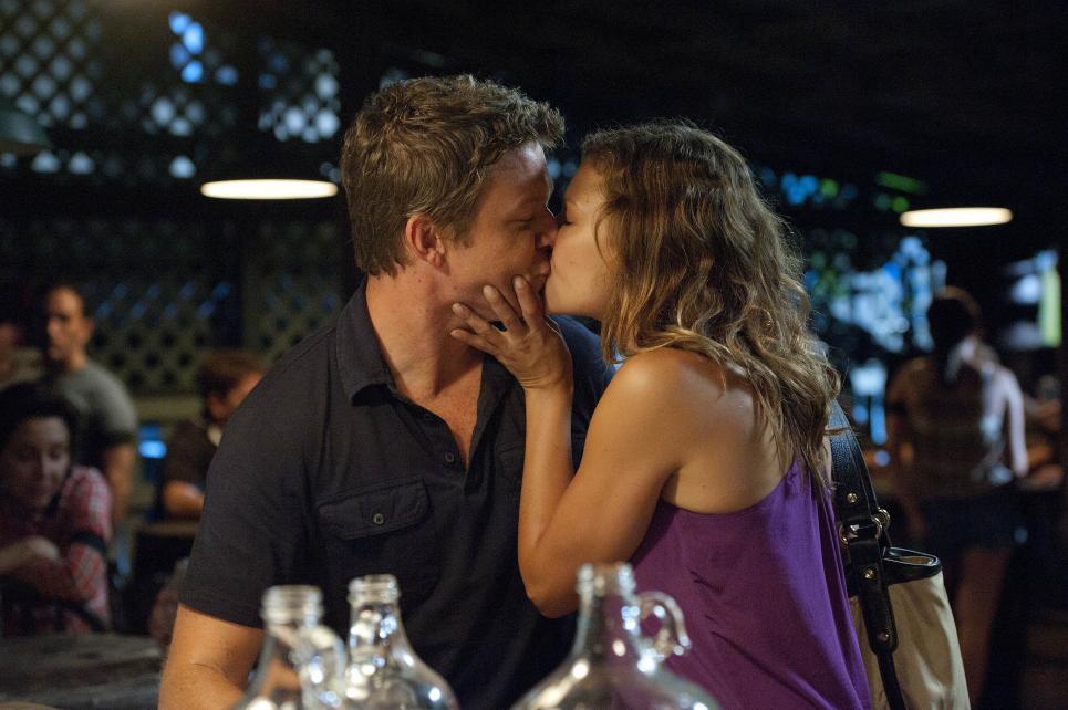 Callie kisses Jim before leaving bar