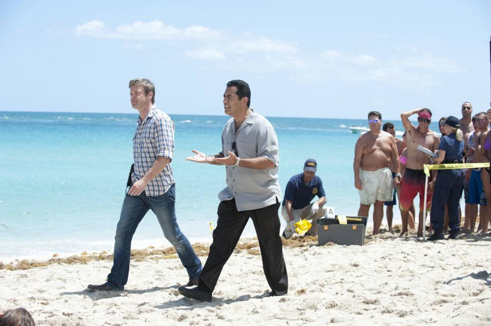 Carlos and Jim walk toward Daniel Green