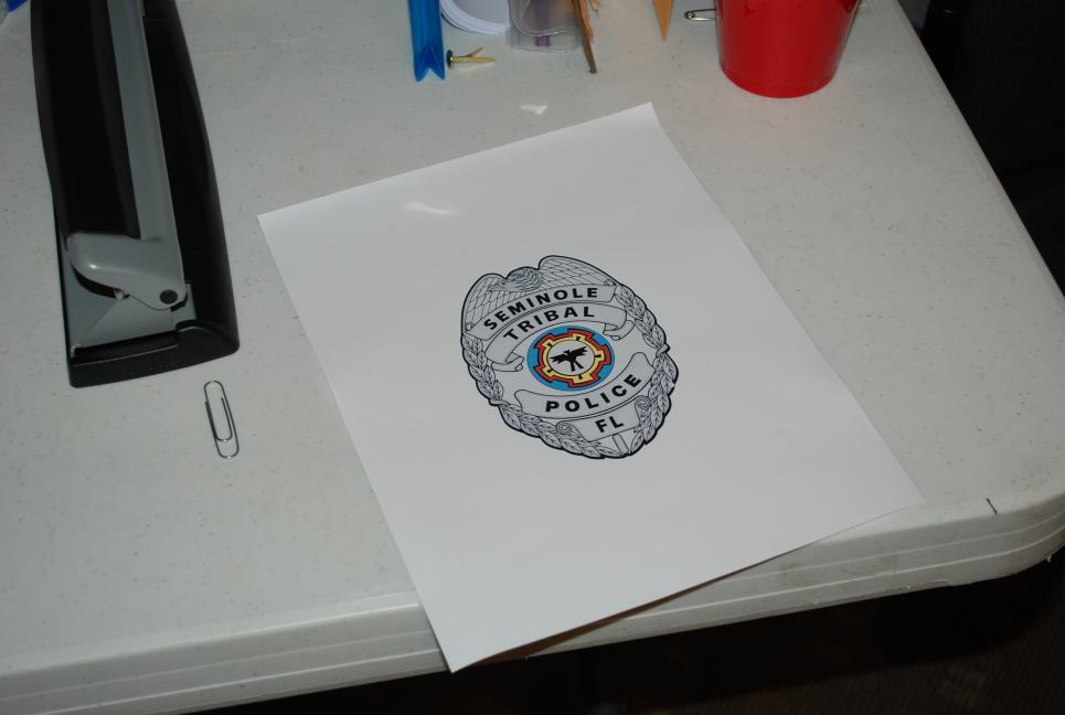 Police badge rendering in art department