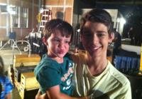Uriah Shelton plays with production supervisor's son