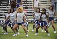 Muck City cheerleaders perform routine