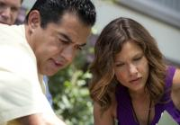 Carlos and Callie examine Enid's body