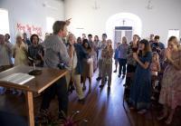 Jim tries to warn congregation