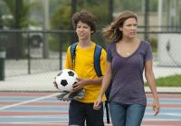Callie and Jeff walk across soccer field