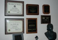 Diplomas in office of Carlos Sanchez