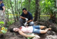 Carlos examines body of Bree Michaels