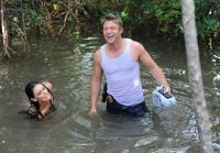 Jim laughs when Jennifer falls in water